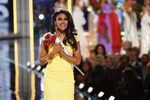 Nina Davuluri received her crown, as well as harsh and racially fueled criticism from the American public.  www.nytimes.com