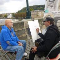 The Charles Bridge provides a studio for artists like Ylevgeni Shtchemenko (photographed).Photo by Madeleine Overturf.