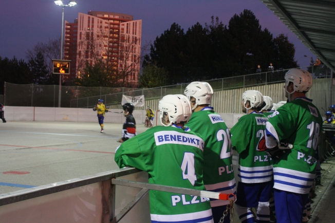 HBC Plzen team members watch from the sidelines. Photo by Ray Paul Biron.