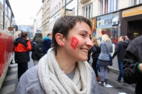 "A woman painted the symbol for ""pussy"" on her cheek, in reference to President Milos Zeman's use of the Czech word for ""pussy"" in a radio broadcast. He described the Russian band, ""Pussy Riot,"" as ""fucked up"" and ""shit"" for criticizing Russian president, Putin. His profane language in the public arena elicited widespread condemnation."