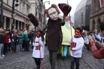 Marchers satirize Russian president, Vladimir Putin.
